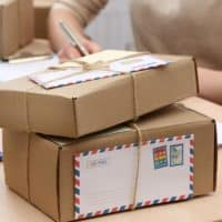 Cardboard-boxes-on-work-place-in-post-office-Mail-Packages